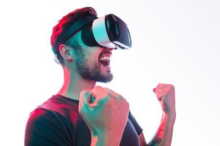 Happy man in VR glasses celebrate win