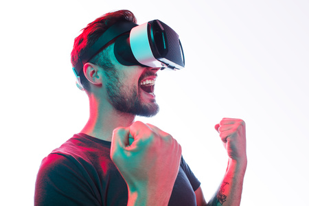 Happy man in VR glasses celebrate win