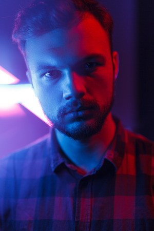 Casual man in blue neon