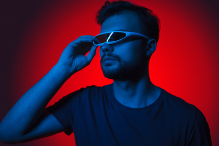 Casual man in futuristic glasses