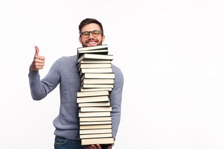 Content man with books holding thumb up