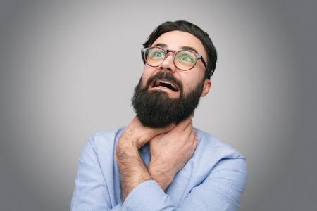 Bearded man suffering from choke Stock Photo
