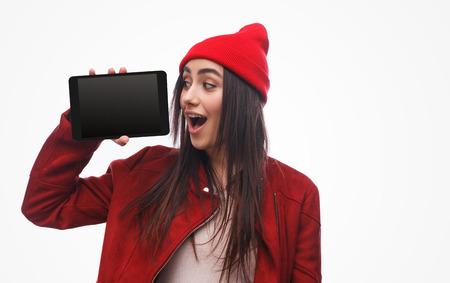 Bright brunette demonstrating modern tablet