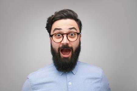 Shocked bearded man in glasses