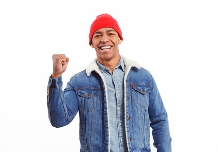 Happy black guy holding fist up