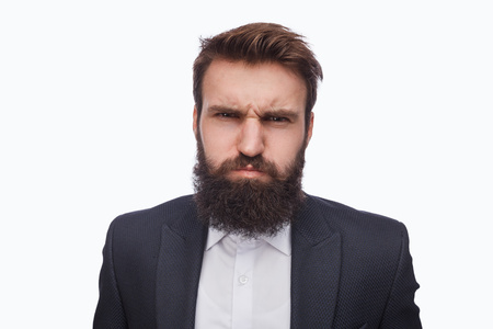 Grumpy bearded man in suit on white 版權商用圖片