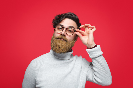 Confident man with glittering beard Stock Photo