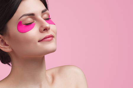 Attractive young woman having under eye mask Stok Fotoğraf