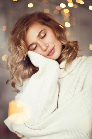 Dreaming sensual model in sweater Stockfoto