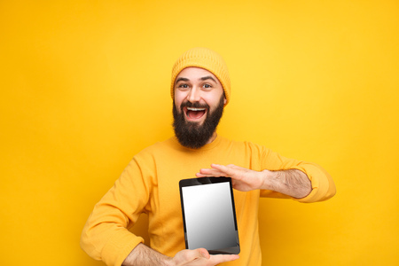 Bright male model with tablet for sale