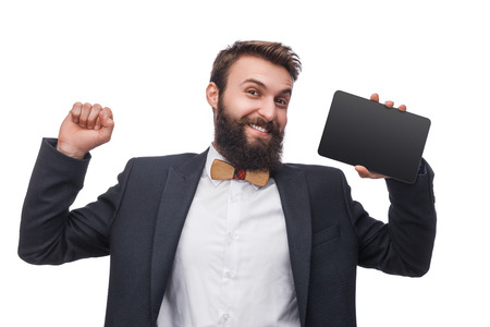 Man in suit holding tablet in studio