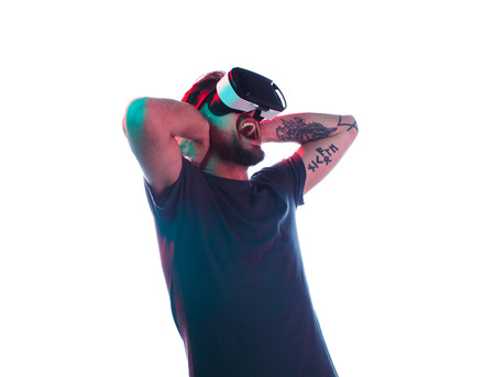 Man in VR goggles screaming 스톡 콘텐츠