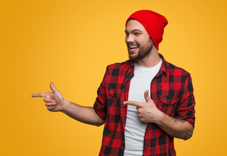 Cheerful man pointing left Stock Photo