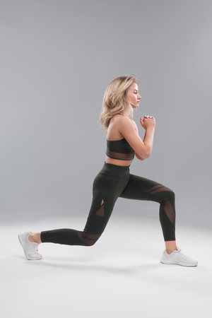 Sportswoman working out on white background Stock Photo