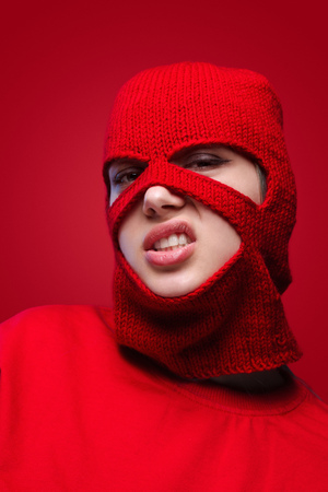 Angry woman in knitted balaclava