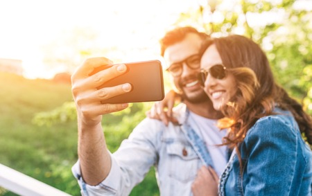 Happy smiling beautiful couple taking a selfie picture