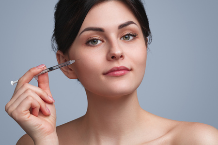 Charming woman having cosmetic injections Stock Photo