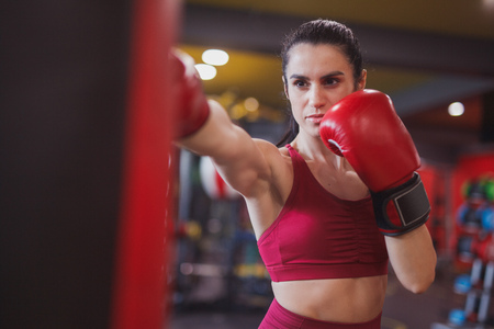 Adult woman boxing in gym