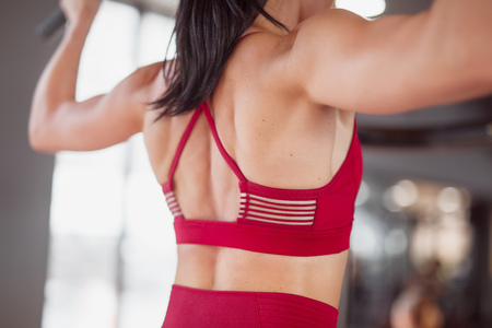 Back of woman in gym Stock Photo