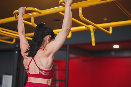 Anonymous woman doing pull-ups