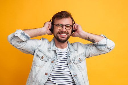 Cheerful modern man listening to music
