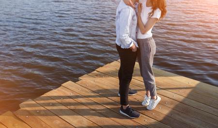 Crop couple hugging on pier