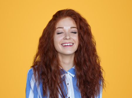 Content charming redhead woman smiling