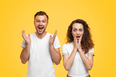 Shocked couple looking at camera