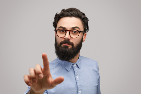 Bearded man interacting with invisible screen