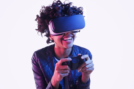 Laughing black teenager playing VR game Stock Photo
