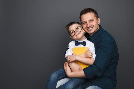 Happy father hugging schoolboy 版權商用圖片