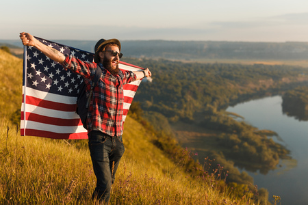 Cheerful traveler with USA flag