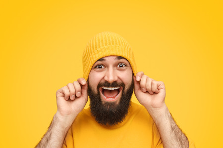 Funny man pulling down hat