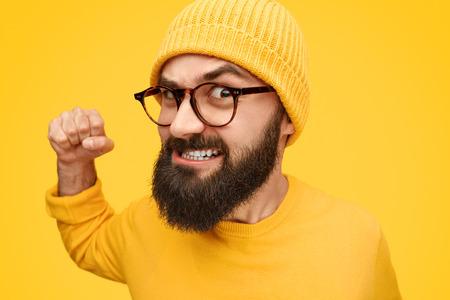 Angry hipster punching camera