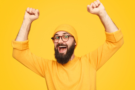 Bright colorful hipster with arms raised