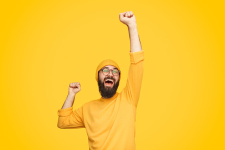 Excited bright man with fist up Stockfoto
