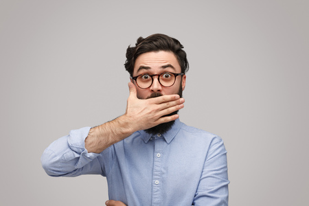 Shocked man covered mouth