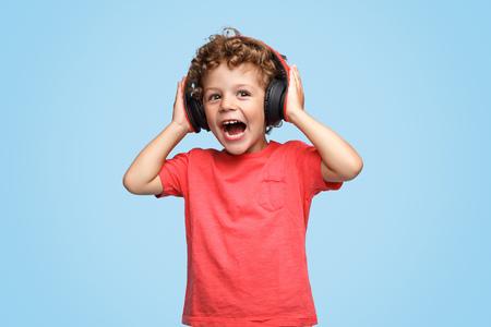 Loud boy listening to music 스톡 콘텐츠
