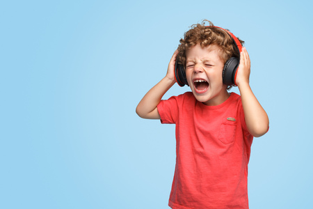 Boy listening to music and screaming