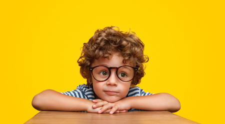 Smart curly boy in glasses Stock Photo