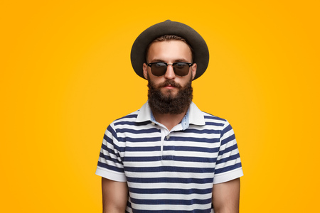 Serious bearded hipster in hat