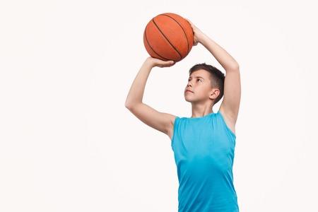 Boy throwing basketball ball Stock Photo