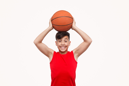 Cheerful boy holding ball on head Stock Photo - 117410503