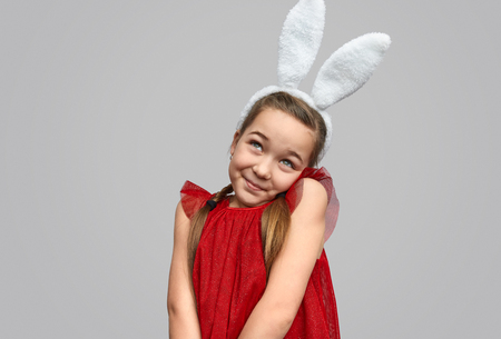 Coquettish little girl in bunny ears