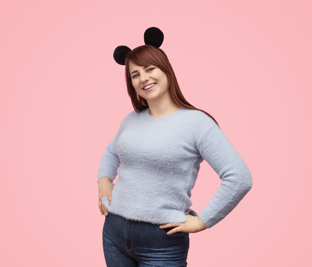 Playful chubby girl in mouse ears