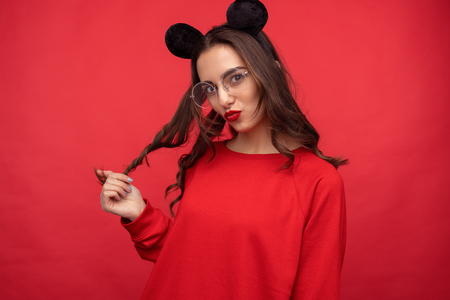 Flirty bright girl in mouse ears Stock Photo