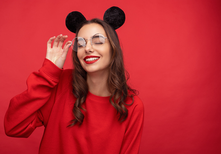 Dreaming girl in mouse ears and glasses