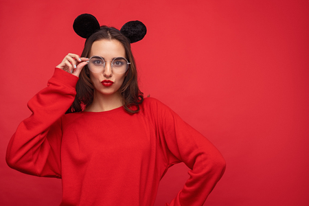 Playful colorful girl in mouse ears pouting lips