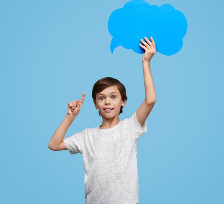 Smart boy showing blank speech bubble