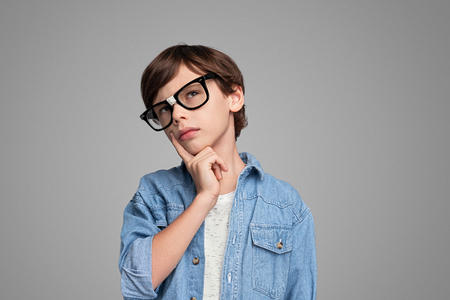 Smart boy thinking and looking up Banco de Imagens